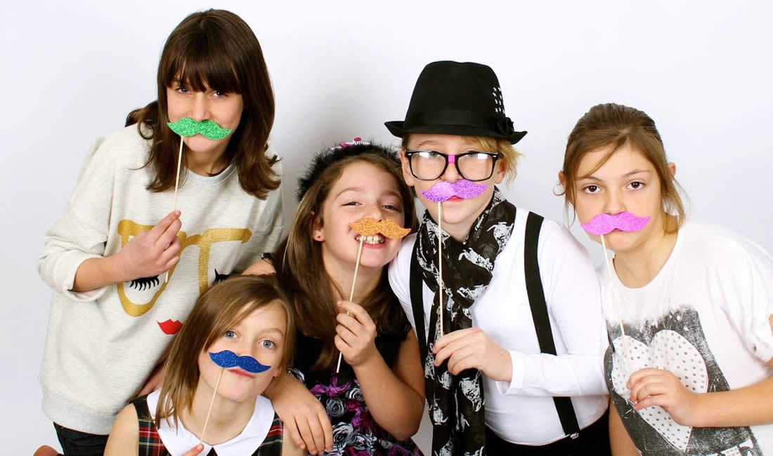Children with photobooth props