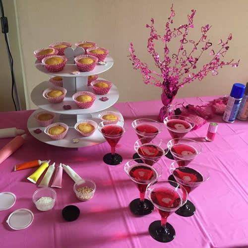 Cupcakes on a stand with party drinks