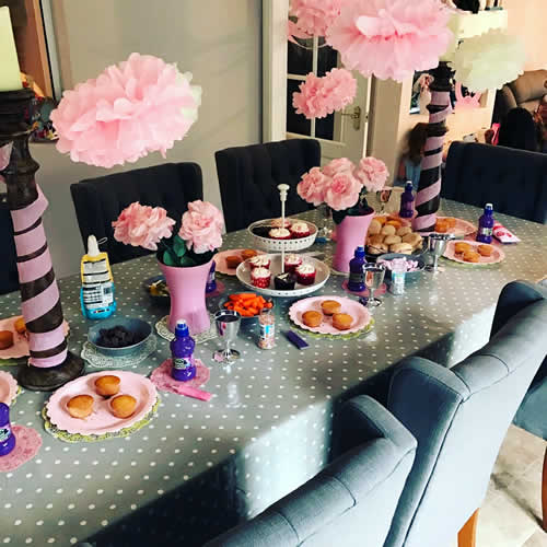 Table laid with party food and decorations